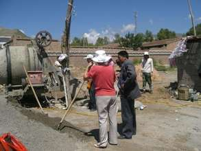 Dr. Tseringy Kyi mixing cement