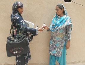 Tahira and a Health Worker