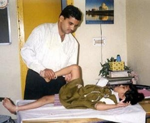 Physiotherapy for a disabled child by a specialist
