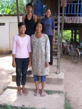 Lun Vandy (pink shirt), English language student, with her famil