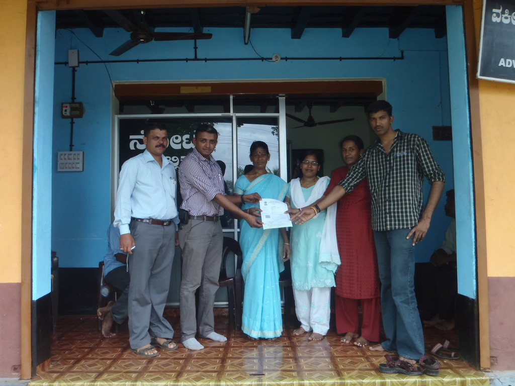 Gulabi and family with signed relocation agreement