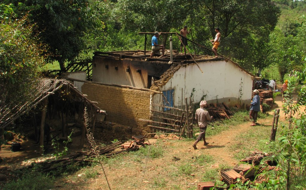 Uruni villagers dismantling their houses