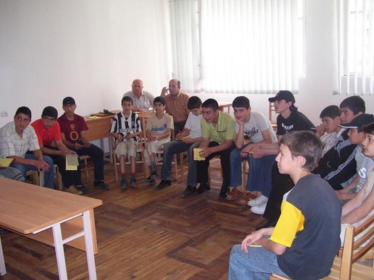 The meeting of the staff, volunteers and the children