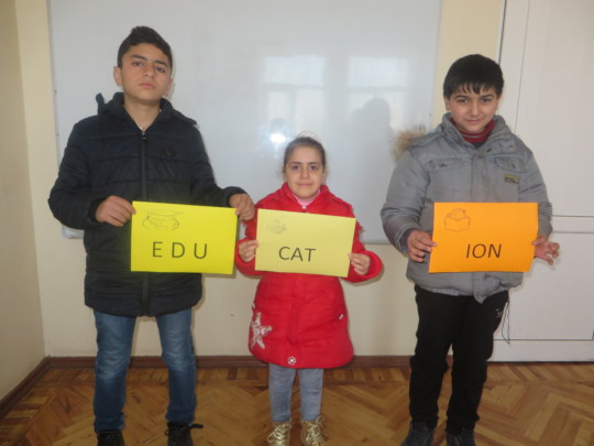 The children show the word EDUCATION