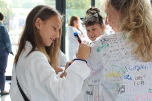 greenlight girl in Krakow signs Founder's labcoat