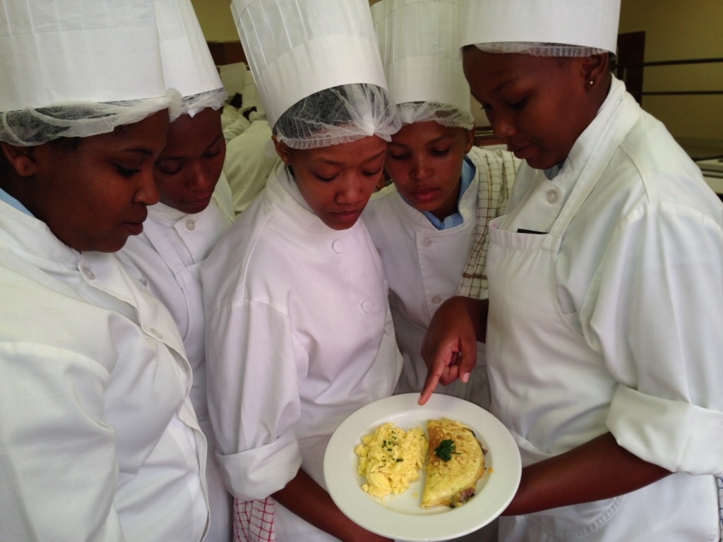 Students learning the art of making breakfast