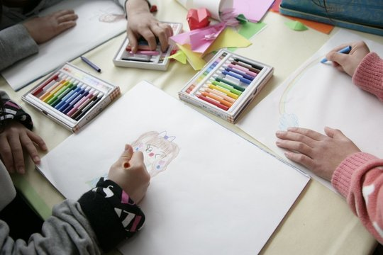 Children Coloring in a Child Friendly Space