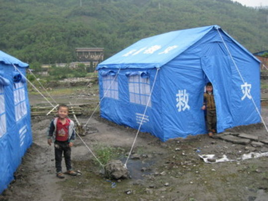 2 boys living in a tent camp in Shapin Village