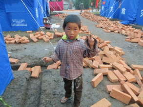 Li Zixin in camp for displaced persons in China