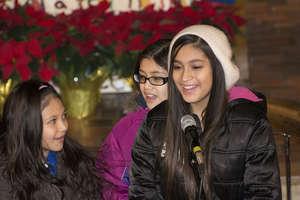 "The Martinez family performs ""Feliz Navidad"""