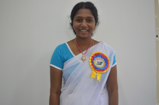 Bhavani, proud with her completion ribbon.