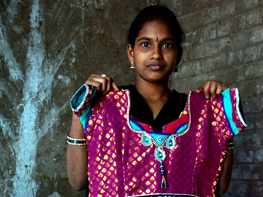 Gowri is proud of the fine clothing she creates.