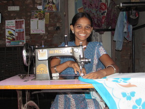 A sewing machine allows a woman to earn an income