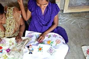 A women hand stitches a beautiful design