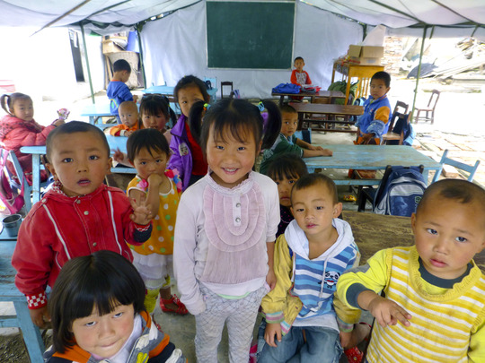 Young children gather in classroom