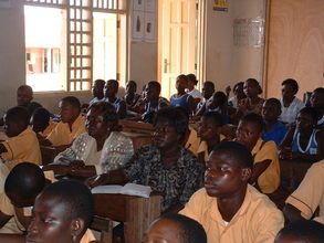 Teachers and students listening attentively