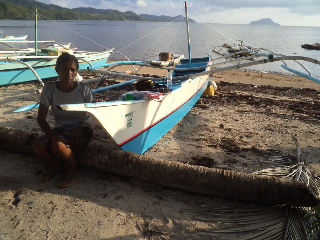 A boat repair beneficiary in Buluang barangay