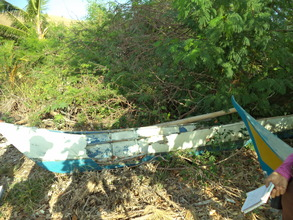 BEFORE: A fishing boat damaged by Typhoon Haiyan