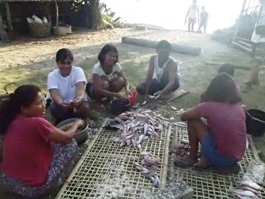 Women in Buluang barangay with the daily catch