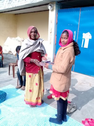 HSN staff deliver note books at pupils home