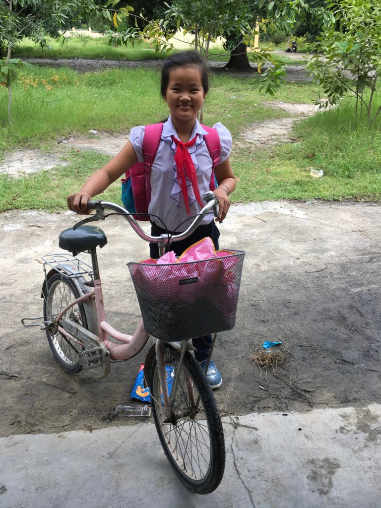 Trinh and her newly repaired bike