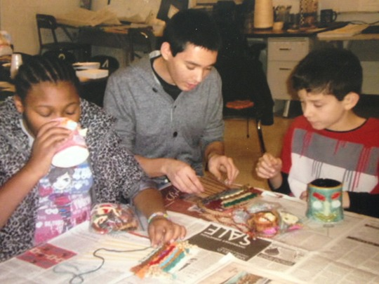 James helping two students work on a weaving!