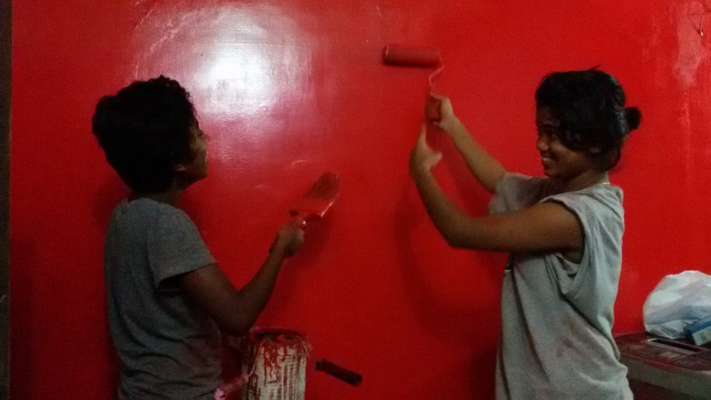 Kavita & I painting the staff room.