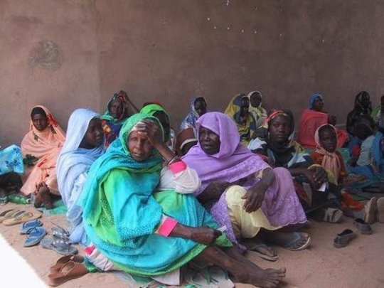 women waiting at RI clinic in Tawilla