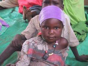 IDP youth waiting with her mother outside Tawilla