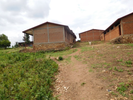 #3: Roofed orphan home behind the school