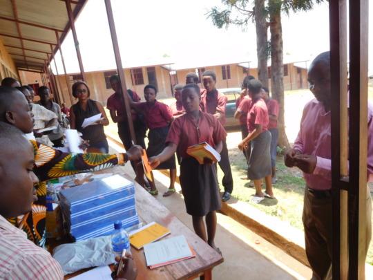 #3: Students receiving school materials