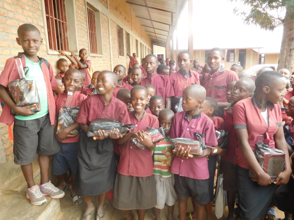 #1:  Students enjoying received school materials