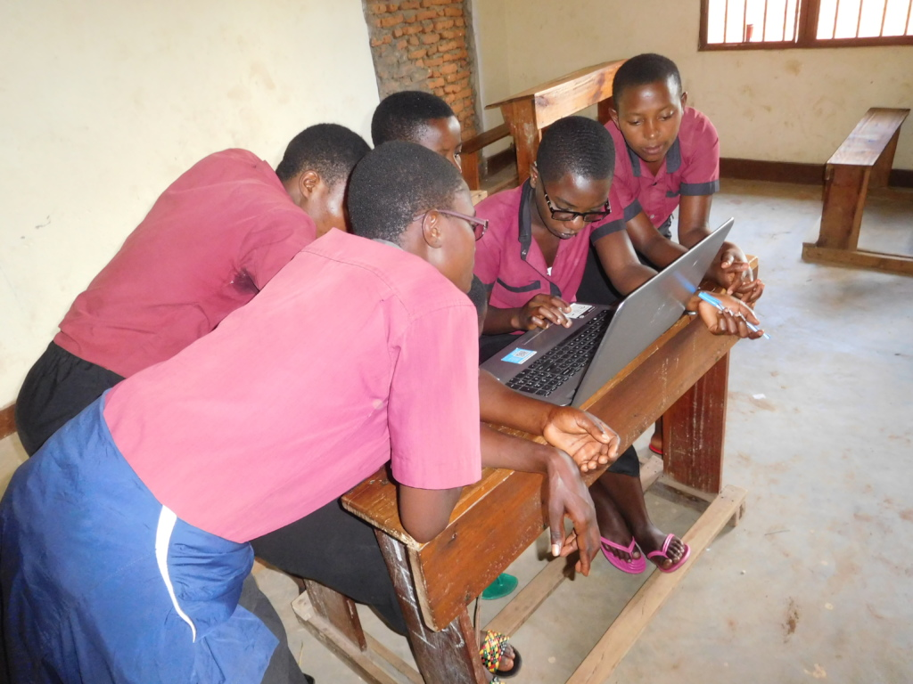 #2-Five students using one laptop