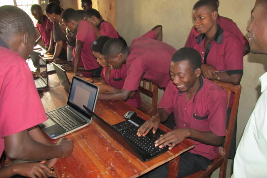 Students learning how to use computer