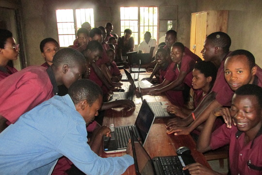STUDENTS EXCITED TO LEARN HOW TO USE A COMPUTER