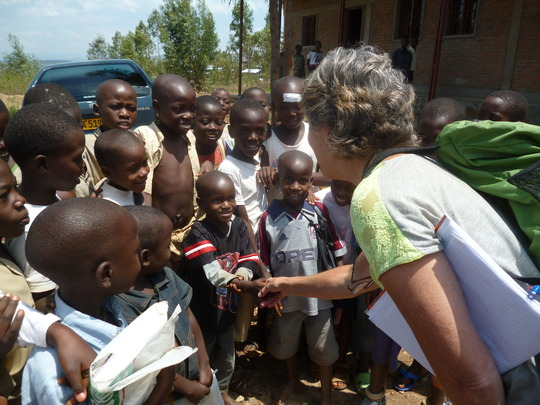 #2. One of our donors greetings students at school