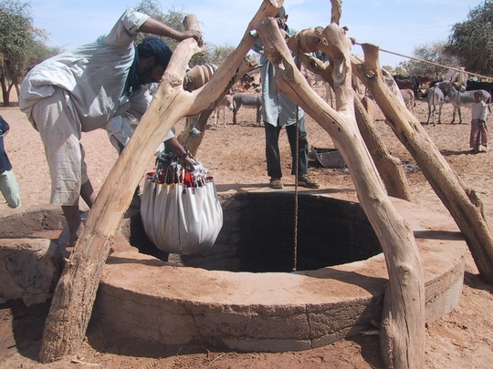 People working on a well