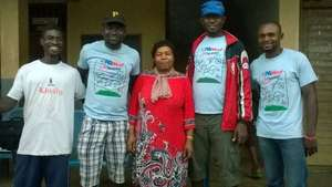 Coaches stand with Madam Director of Female Fball