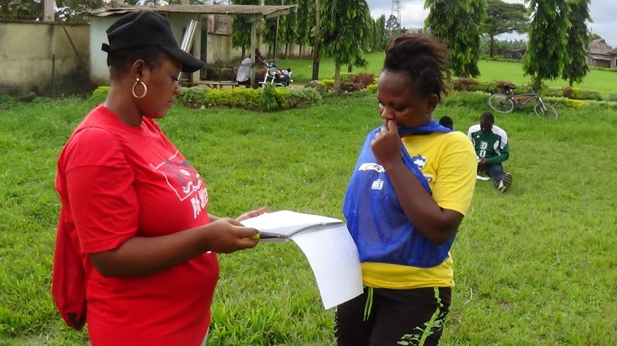 Nenne discusses with Team Captain, Janet