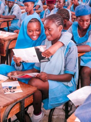 Girls Reading Information on Teenage Pregnancy