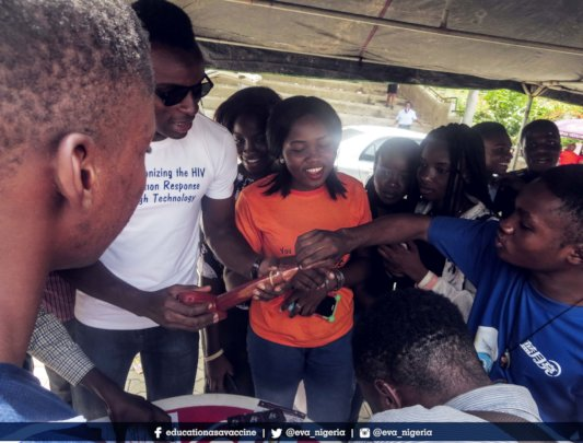 A student demonstrating how to use the male condom