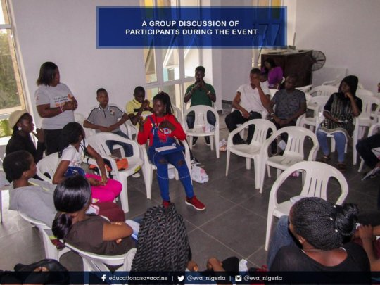 Facilitating a group session with adolescents.