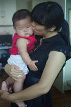 Yan Feng gets kisses and cuddles from his teacher