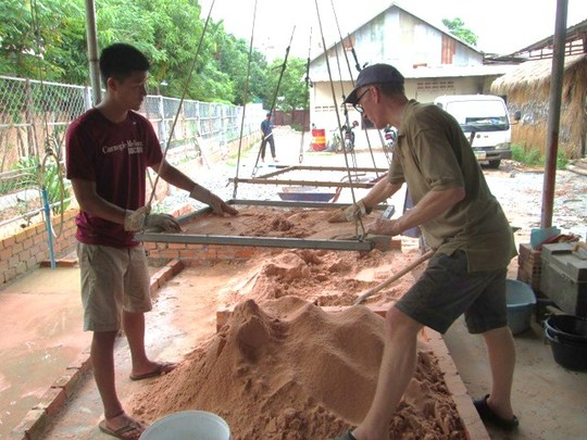 Volunteers sifting filtration media at work site