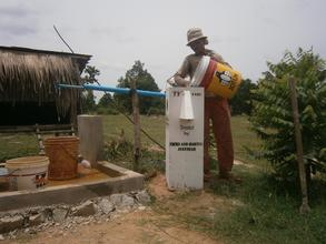 Village woman trying out her new water filter