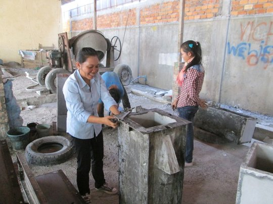 Trainees on building bio-sand water filters