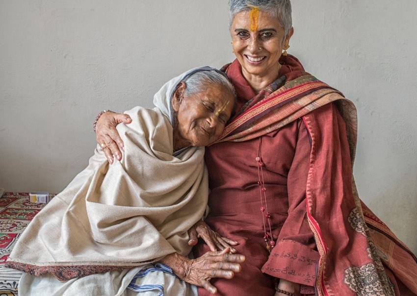 Our founder shares a warm moment with a widow