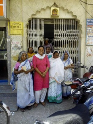 Widows visit local bank to widhdraw their pension