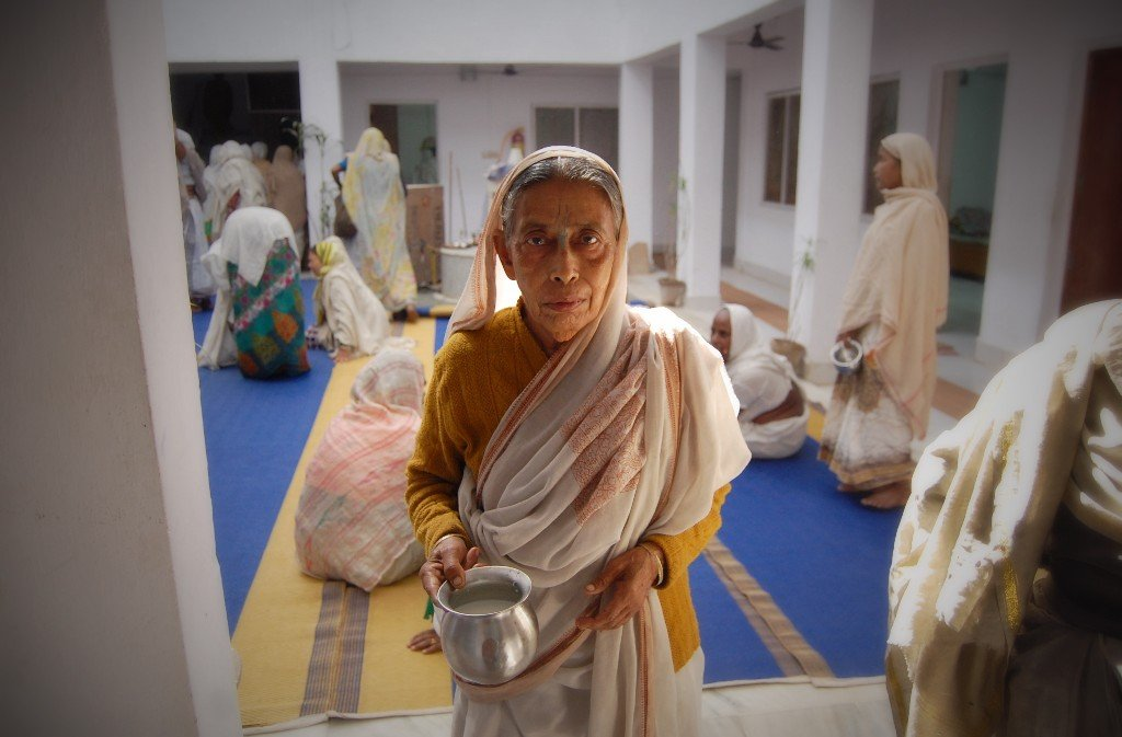 Nirmala, collecting the daily supply of milk