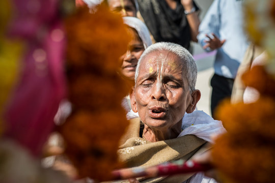 A widow mother chanting prayers
